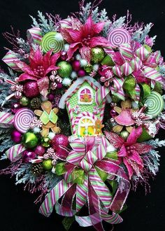 Extra-large Gingerbread House Christmas Wreath ~     Festive, colorful and so season appropriate..love the pink & green! Chic!    Created by UpTownOriginals,