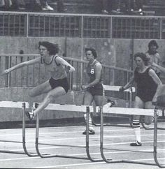 Oregon women's track & field athlete Mary Officer leads in a hurdles race at Hayward Field 1976. From the 1976 Oregana (University of Oregon yearbook). www.CampusAttic.com