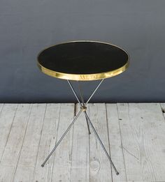 brassy accent table.