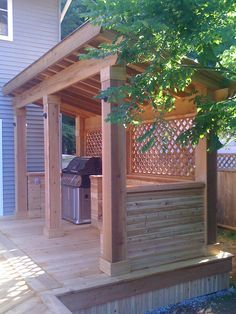 covered bbq and built in L-shaped bench
