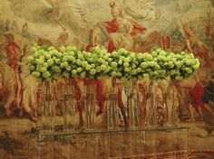 Lovely green hydrangea against an antique tapestry -