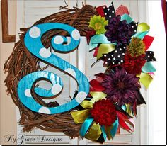 Totally Custom Initial Wreath with flowers ribbon wooden letter and vine wreath Great wedding gift. $49.00, via Etsy.