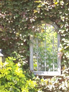 Nothing like a mirror to make spaces look bigger. More narrow garden ideas. #SmallGardenDesign