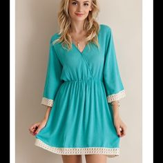 SALE💥Turquoise Crochet Dress A solid crinkle rayon wrap dress featuring crochet lace on hems. Invisible snap button on chest. Elasticized waist. Partially lined. Partially semi-sheer. Woven. Lightweight.  Modeling Small. 100%RAYON. Very Flattering Fit! Price Firm Unless Bundled. Dresses Midi