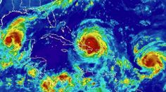 For the first time in modern history, three hurricanes in the Atlantic are simultaneously threatening land.