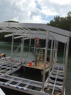 North Georgia Boat Lift & Marine Construction Company completed work on a brand new CAT 5 dock earlier this week. This dock, installed at Lake Fontana, features a standard single-slip combined with a wide-side to house the owner's boat. Ironwood decking was used in the construction of the main dock, the gangway also sporting it. Wahoo bumpers line the inside of the slip, protecting the boat from any damage. The upper level consists of a deck and roof. Dock Ideas, Boat Lift, Decking, Blue Ridge, Outdoor Furniture, Outdoor Decor, Georgia, Construction, Cat