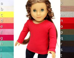 Fits American Girl dolls and other 18 inch dolls   Handmade with care    All NEW fabrics for Winter 2016! This knit fabric is soft and lightweight, leading to a beautiful drape and fit. Treat your doll to high quality t shirts that will perfectly mix and match with many other garments and accessories!    { The Basic Tee, You Choose Color and Sleeve Length }    Features:  --- made from knit cotton  --- closes in back with velcro  --- choose from 3/4 length, cap sleeves, or long sleeves…