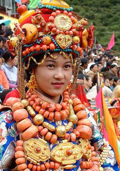 Tibetan lady modelling an a super expensive and heavy ceremonial replete with rare gold ornaments and coral beads.  By BetterWorld2010