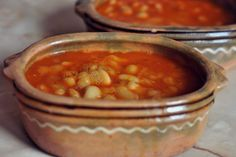 BEAN STEW Bean stew is a traditional Macedonian dish. It's usually prepared on Friday, I don't know why :) Some like it plain, some combine it with sausages, some with dried smoked ribs. I prefer beans plain in combination of fresh salad and some white cheese and olives. I have small earthenware dishes at home and I serve beans in them. Looks lovely right? :)