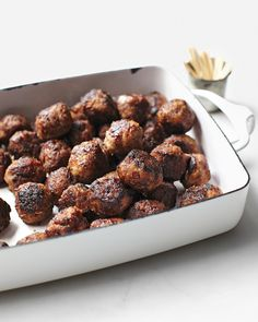 Cocktail Meatballs | Martha Stewart Living - To give them a light crust, which makes them easier to pick up, meatballs can be rolled in a breadcrumb-and-flour mixture before frying.