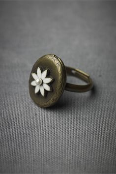 Locket Ring  $70.00. pshhh only SEVENTY DOLLARS. in my dreams. still cute though