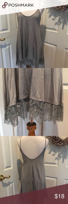 Flowy gray long cami, or top extender Gray rayon cami that is great alone or under something for some more length.  Laying flat it is 30 inches long in front and 32 in back.  Lots of fabric near the bottom so it hangs nice.  Brand new without tags. Freshman Tops Camisoles