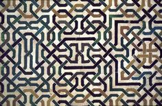 Image SPA 1203 featuring decorated area from the Alhambra, in Granada, Spain, showing Geometric Pattern using ceramic tiles, mosaic or pottery.