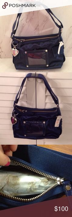 "Slinky Navy Blue Juicy Couture Handbag Purchased from Neiman Marcus. Still has original tissue inside. Adjustable strap for over the shoulder, navy blue. Not velvet, super silky and slick. Gorgeous bag! 12"" L, 7"" H, 4.5 W Juicy Couture Bags Shoulder Bags"