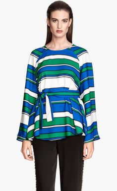 Visually interesting with a flattering belted waist-- I love this top. The pattern prevents the high neckline and long sleeves from seeming too frumpy.