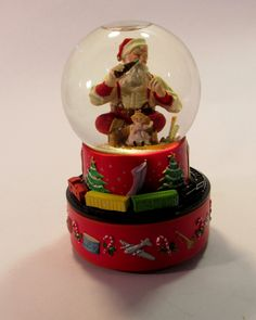 Vintage  Hallmark Coca Cola Snow Globe  Music Box with Santa Drinking a Coke Surrounded by Christmas Toys.  The Music Box was made in 1971. by VintageQualityFinds on Etsy