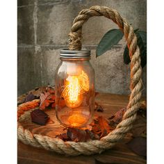Luke Lamp Co - The rustic lighting of Luke Lamp Co. is full of character. Made out of repurposed everyday materials such as manila rope, mason jars and books, the. Rustic Lamps, Rustic Lighting, Outdoor Lighting, Rope Lighting, Outdoor Lamps, Nautical Lighting, Unique Lighting, Outdoor Spaces, Decorating Your Home