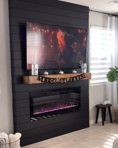 Fantastic Photographs Electric Fireplace with mantel Style Before and after – Black shiplap buildout. Mounted our tv, mantel and electric fireplace! Electric Fireplace With Mantel, Fireplace Tv Wall, Basement Fireplace, Build A Fireplace, Shiplap Fireplace, Black Fireplace, Fireplace Remodel, Living Room With Fireplace, Fireplace Design
