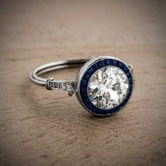 Estate Engagement Ring A beautiful Old European Cut Diamond Engagement Ring with a Sapphire Halo.A beautiful Old European Cut Diamond Engagement Ring with a Sapphire Halo. Antique Jewelry, Vintage Jewelry, Estate Engagement Ring, Diamond Engagement Rings, Wedding Engagement, Art Deco Jewelry, Fine Jewelry, Jewellery Box, Bracelets
