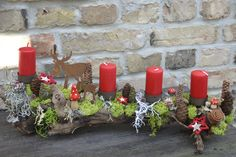 An advent arrangement with which you can go on a voyage of discovery, because each tells . - An advent arrangement with which you can go on a voyage of discovery, because each one tells its ow - Diy Candles, Pillar Candles, Credenza Decor, Bedroom Candles, Advent Wreath, Christmas Bedroom, Door Wreaths, Natural Materials, Beautiful Pictures