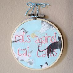 Cats Against Cat Calls quote hand embroidery on cat pattern light blue fabric, 4 inch hoop, feminist, feminism, hoop art