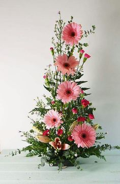 symmetrical front facing arrangement with Gerbera Daisies, mini carnations, and spiral eucalyptus. Altar Flowers, Church Flowers, Funeral Flowers, Silk Flowers, Wedding Flowers, Orchid Flowers, Easter Flower Arrangements, Beautiful Flower Arrangements, Beautiful Flowers
