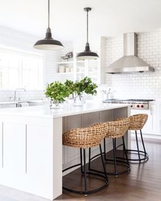 Great White kitchen with rattan stools .... Clean lines in the island ... although with storage being a premium in SWFL maybe more upper cabinets would be in order
