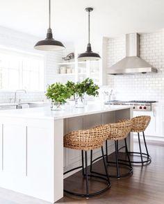 White kitchen with rattan stools