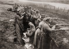 German soldiers take a moment to decorate the trenches in celebration of Christmas during World War I. | 21 Photos Of People Being Wonderful Throughout History
