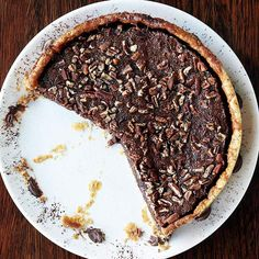 Find your way to dark chocolate bliss with this irresistible Dark Chocolate Pecan Pie. More decadent dark chocolate recipes:  http://www.bhg.com/recipes/party/seasonal/february-2011-flavor-of-the-month-dark-chocolate/?socsrc=bhgpin020413chocolatepecanpie=9
