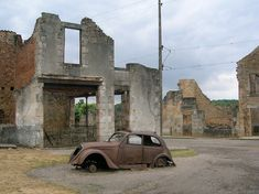 Oradur Sur Glane, France.  Ghost town since 1944. During WWII, Nazi troops completely destroyed this town, killing 642 residents, burning all houses & cars. Tourists are asked to remain silent while walking through the melancholic silent deserted streets....