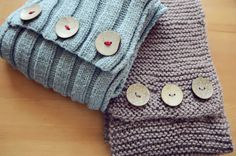 add buttons to make an old knit scarf into a cute new infinity scarf, love the one with contrasting color yarn in the buttons - thanks @Erin Haven