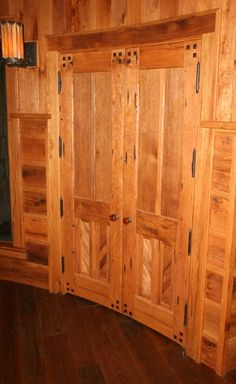 Reclaimed oak doors on the interior of a zen center are curved to match the slope of the surrounding walls. Entry Design, Oak Doors, Doors, Curved Walls, Interior, Custom Interior Doors, Timber Frame, Wood Doors Interior, Doors Interior