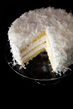 Thomas Keller's Coconut Cake |  Thick Italian meringue is sandwiched between moist layers of cake, which is topped off with sweetened shredded coconut..