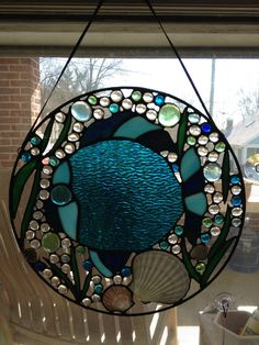 Stained glass fish with sea shells