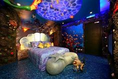 Under the Sea bedroom.... not so much a fan of the hanging blow up mermaid, but the center light thing is awesome..wonder if we could immitate some how Underwater Bedroom, Underwater Theme, Bedroom Designs, Bedroom Themes, Teen Bedroom, Dream Bedroom, Bedroom Decor, Bedroom Lighting, Coolest Bedrooms