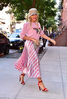 Pretty in pink: His wife Beyonce meanwhile, who has no such sordid skeletons on her CV, wore a much sweeter outfit in all pink