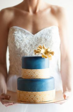 Blue and gold wedding cake.