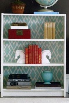 use wallpaper or fabric as bookcase background