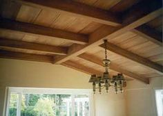 wooden ceiling. If you made it dip down vs up, it would look like the hull of a boat. use old recycled wood.