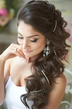 Wedding Hairstyle with long loose curls entwined with diamontes, chandelier earrings  neutral make-up