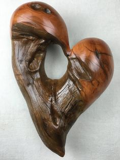 A personalized Anniversary heart wood by TreeWizWoodCarvings