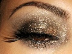 Gold eye make-up... Gotta love the bling think New Years ball drop