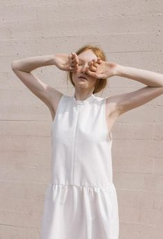 'The Blind Side' - A look book styled by Jayne Min of Stop It Right Now featuring Luisa et La Luna // stadium, white dress, white summer dress, minimalist editorial, editorial, editorial inspiration, minimalist style, red hair, los angeles, the dreslyn