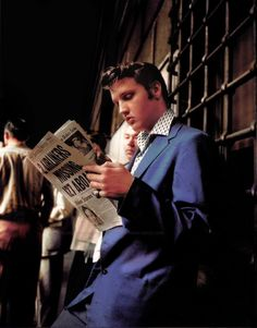 Elvis reads the newspaper