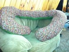Pregnancy pillows on a budget. The writer shares how she cobbled together her pregnancy pillow on a tight budget.