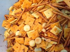 My version of Cracktastic Snack Mix. 3/4 c canola, I pkg ranch dressing mix and about 2 T red pepper flakes, roughly 3/4 box original cheezits, 1/2 box white cheezits, half a can of unsalted peanuts, half a bag of pretzel sticks and half a bag of Nabisco oyster crackers. Mix the sauce together and let it sit a bit. Then toss with crackers in something big enough to really get them mixed well. Spread on baking sheet and bake at 250 for 15 minutes.