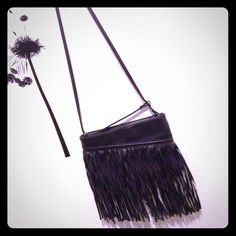 Express Fringe bag Black bag. Fringe. Looks small but can fit a lot of things. Fake leather. Black strap Express Bags Crossbody Bags