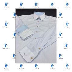 Τρικολίνα Ιταλίας (βαμβάκι) σχέδιο λαχούρι. Γιακάς Ημι-Rex,μανσέτα κοφτή και γαρνιτούρα γαλάζια σε γιακά και μανσέτα. Μονόγραμμα με λατινικούς χαρακτήρες στην μανσέτα. Κουμπί ξύλινο,κουμπότρυπα στο χρώμα του πουκαμίσου.
