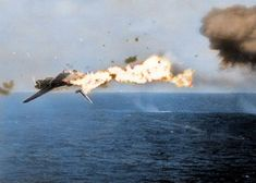 A Japanese Nakajima B6N 'Tenzan' torpedeo bomber is hit by a 5 inch shell while attacking the USS 'Yorktown' aircraft carrier off Kwajalein Atoll, Marshall Islands, North Pacific. Mid-day on the 4th December 1943.